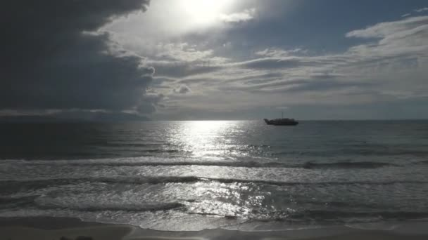 Sea views and the ship on the background of an approaching storm