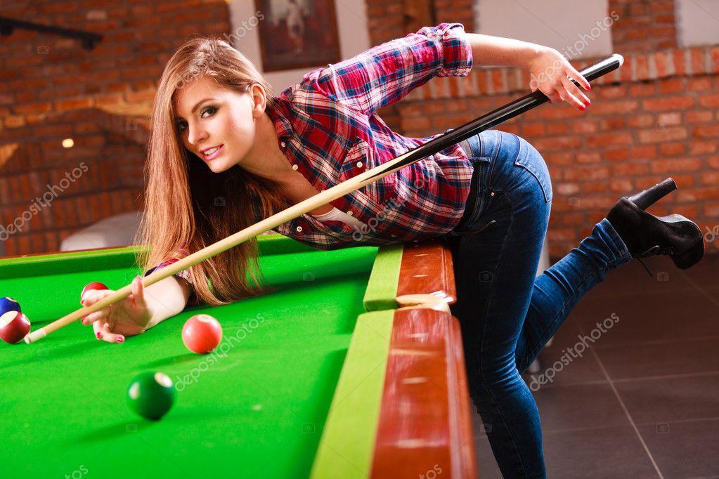 Young Fashionable Girl Playing Billiard Stock Photo