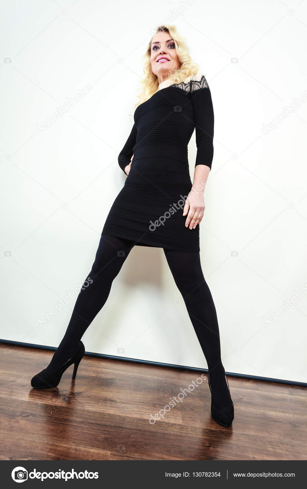 Mid Aged Woman In Stylish Black Dress Stock Photo C Voyagerix