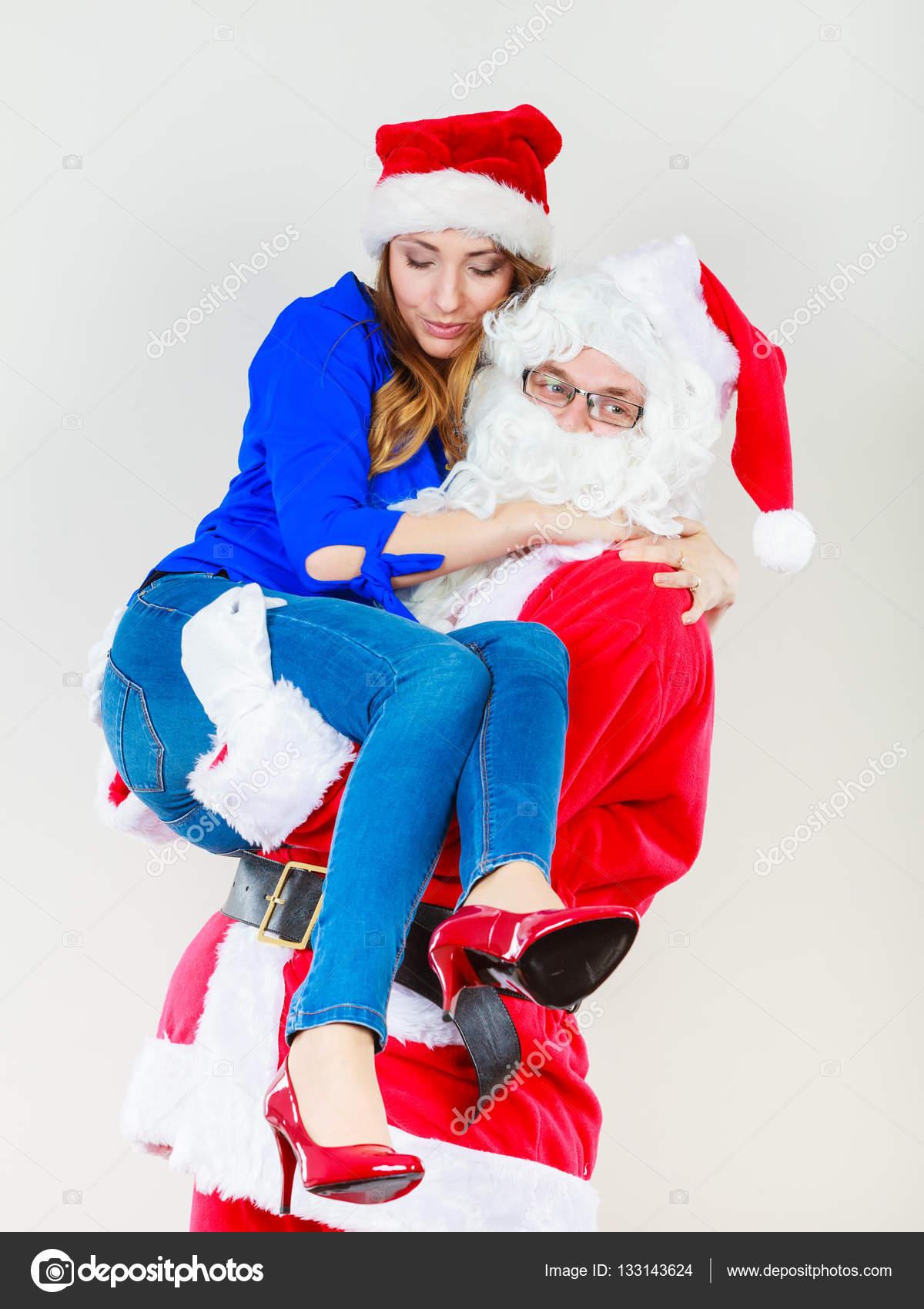 Holding Natalizio Con Donna Babbo Il Natale Della Cappello qxRvvH