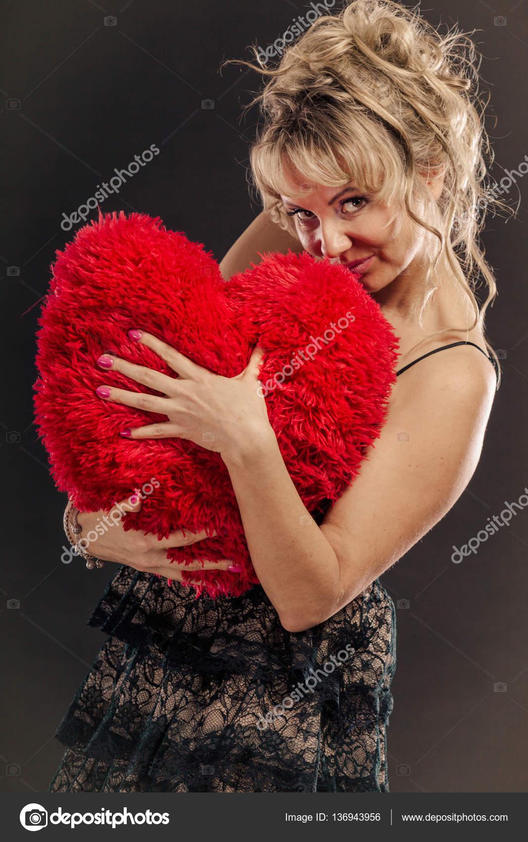mature woman hug big red heart — stock photo © voyagerix #136943956
