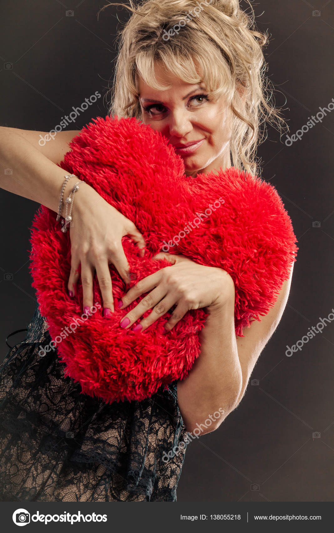 mature woman hug big red heart — stock photo © voyagerix #138055218