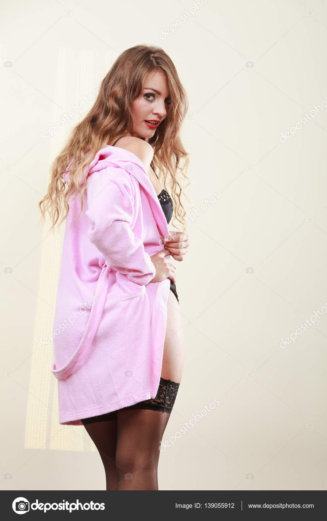 Seductive lady in dressing gown. — Stock Photo © Voyagerix #139055912