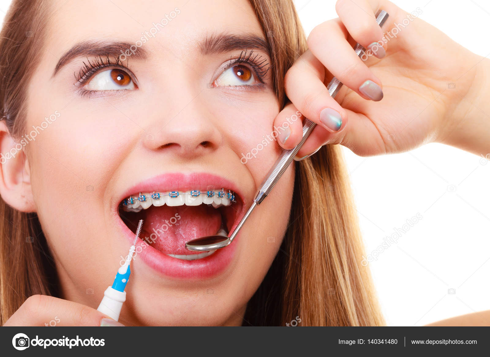 depositphotos_140341480-stock-photo-woman-smiling-cleaning-teeth-with.jpg