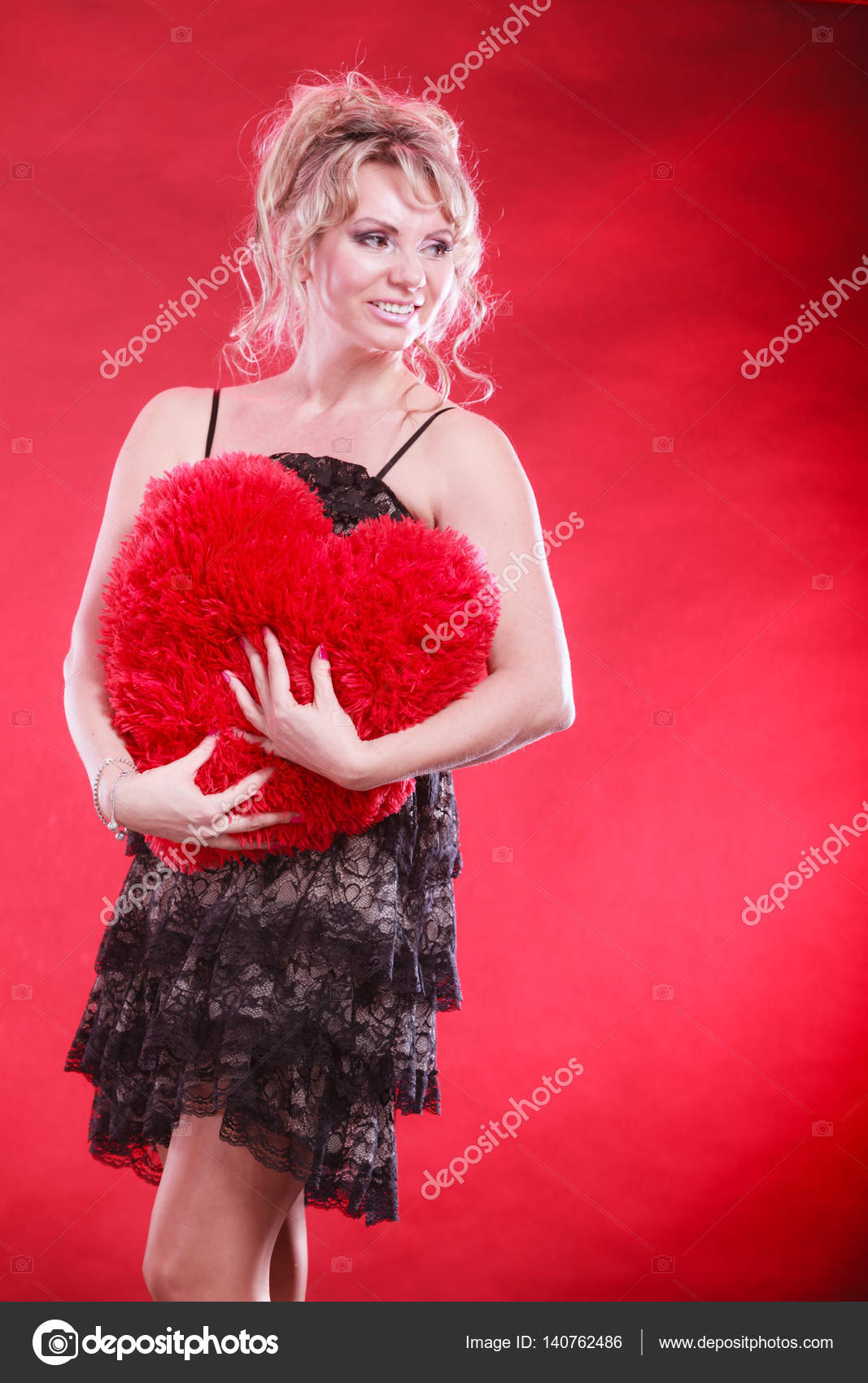 mature woman hug big red heart — stock photo © voyagerix #140762486