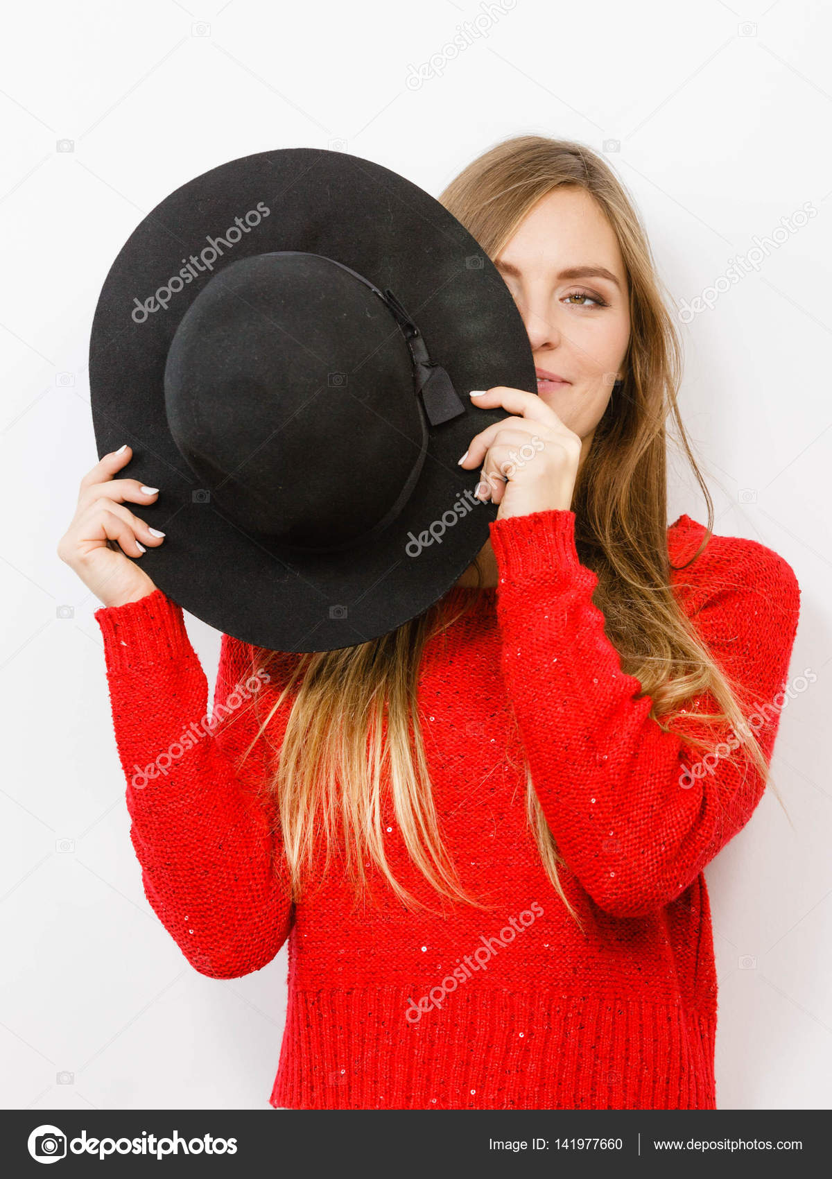 e05f4b74462 Fashion elegant clothing fun gesture concept. Young lady hiding her face.  Yothful blonde girl covering herself with hat. — Photo by Voyagerix