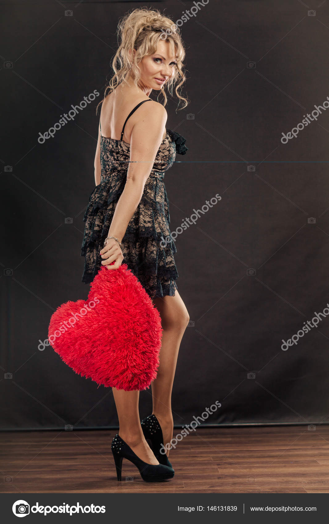 mature woman holds big red heart — stock photo © voyagerix #146131839