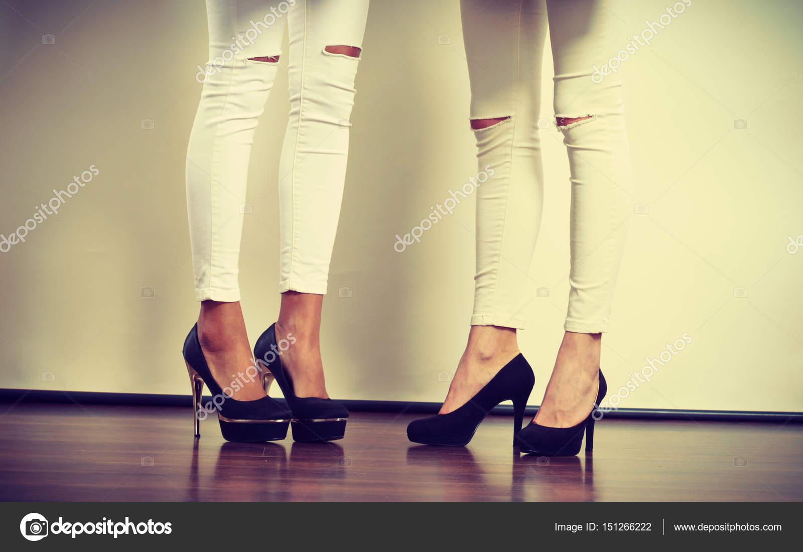 d9b108bb0 Fashion, clothes, clothing accessories, trendy outfits concept. Two women  legs presenting high heels wearing white slim trousers with holes on knees  — Photo ...