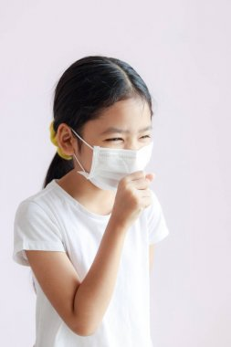 Portrait of Children wearing sanitary masks and coughs. The epidemic of the flu, Coronavirus or COVID-19 and illness with smog.