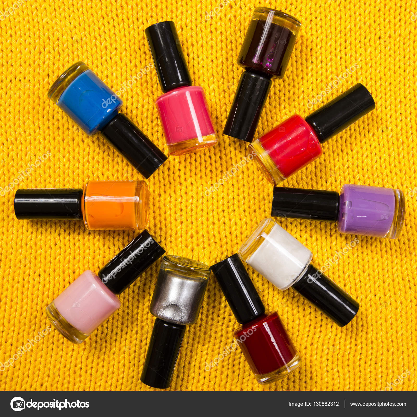 Stack of colorful bottles of nail polish arranged in a circle ...