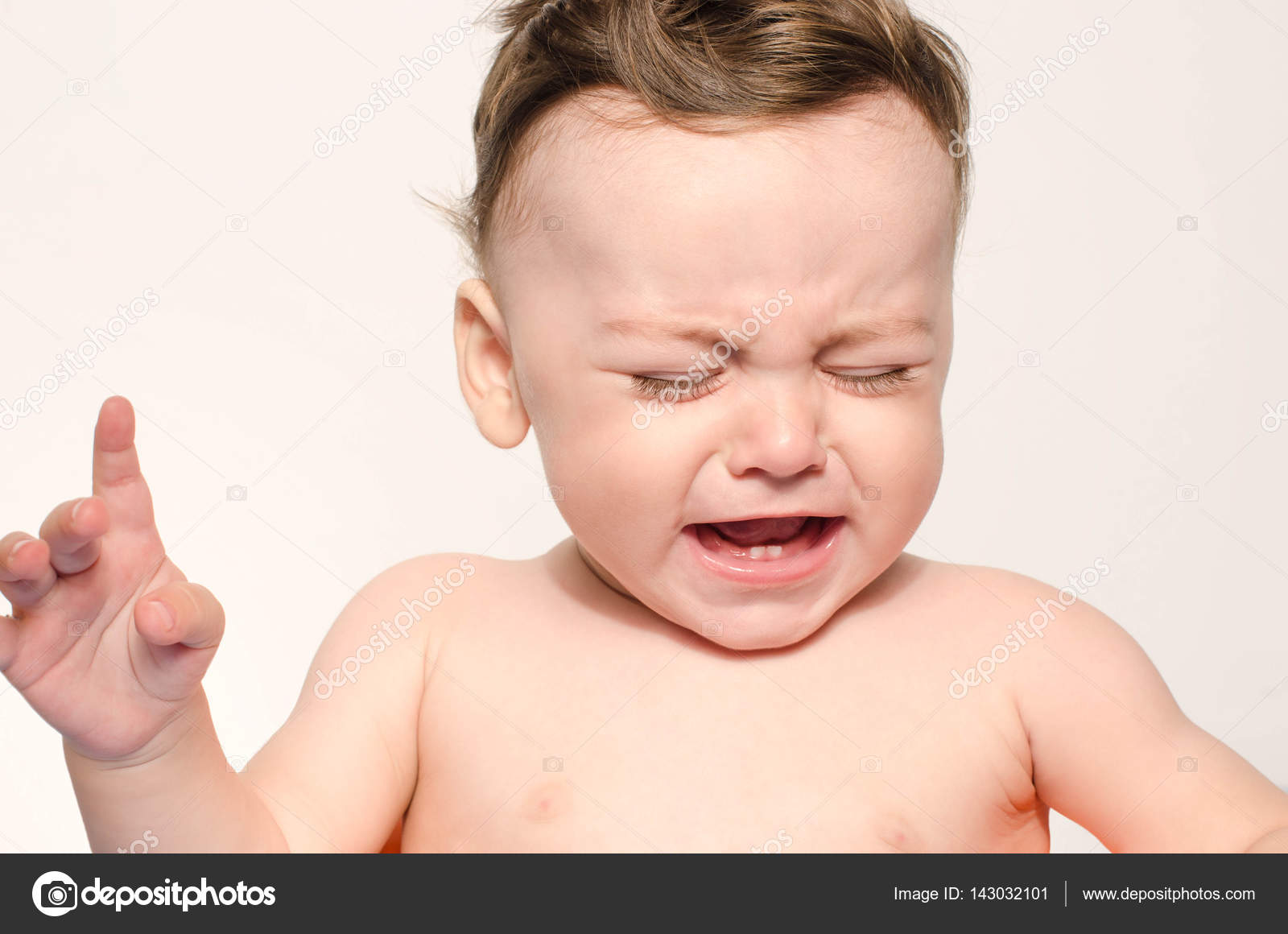 cute naked baby boy crying. little child in pain, suffering