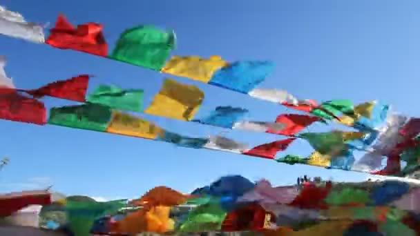 Buddhist tibetan prayer flags waving in the wind , Shangri-La ,China