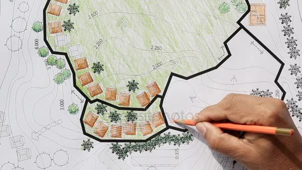 Zahradní architekt navrhuje plány pro Resort