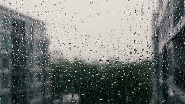 drops of rain on a window pane buildings in background. Black Bedroom Furniture Sets. Home Design Ideas