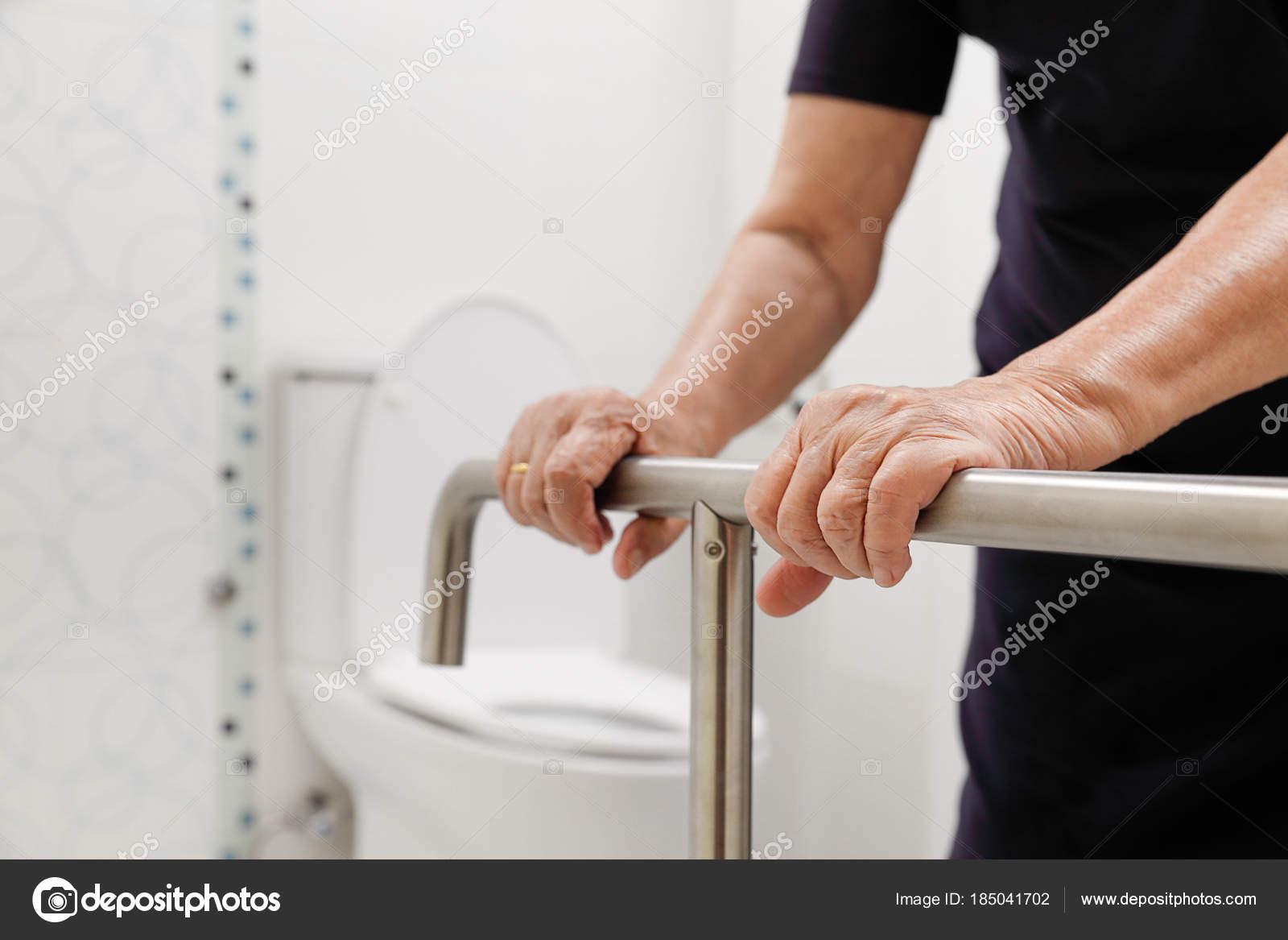 Elderly Woman Holding On Handrail In Bathroom. U2014 Stock Photo