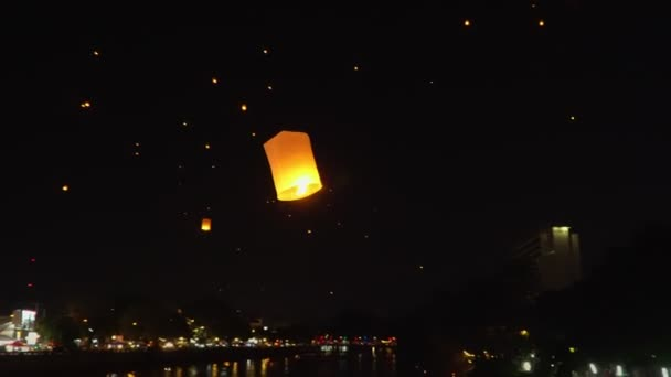 floating sky lanterns at ping river in Chiang Mai ,Thailand