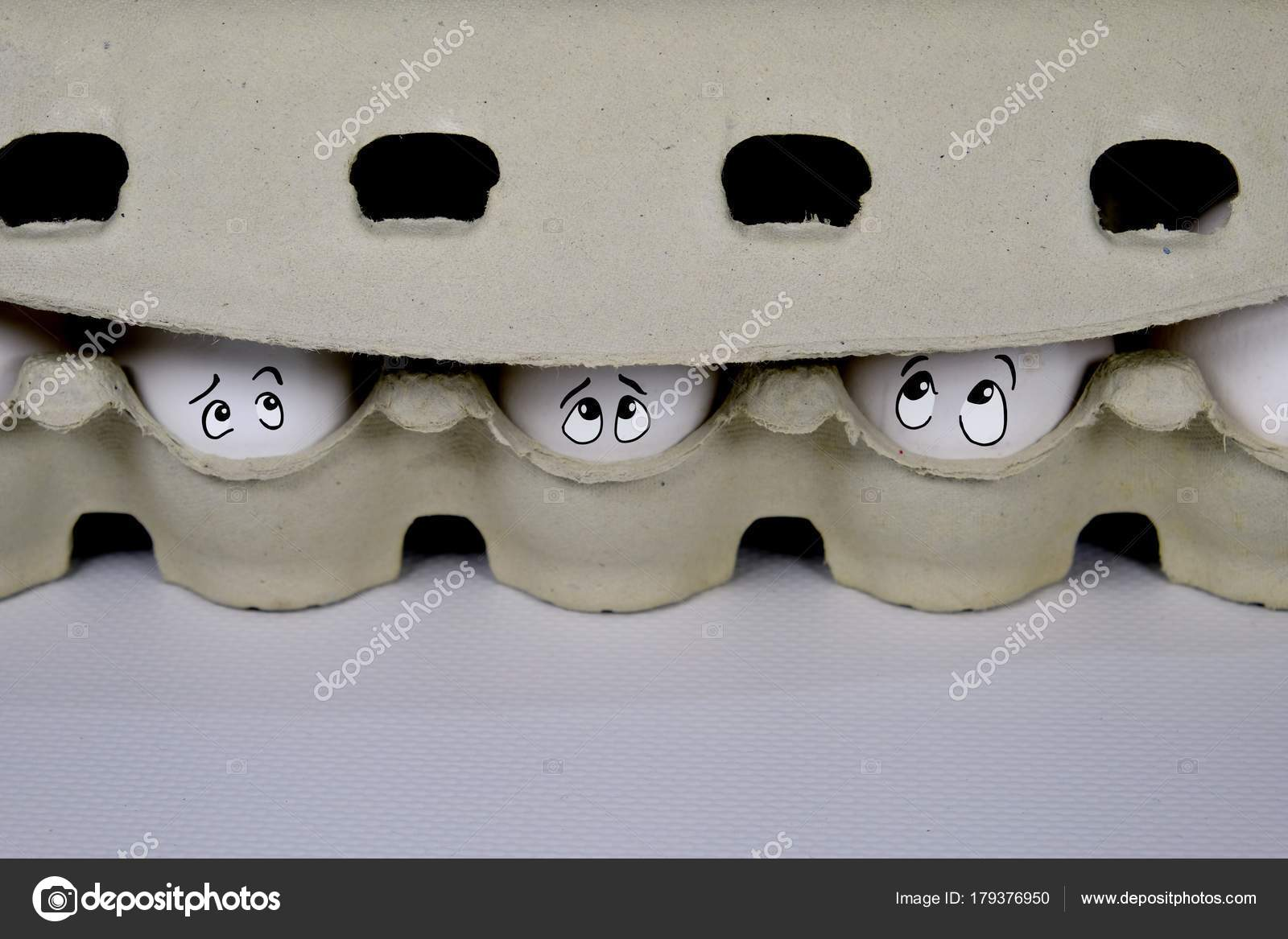 Eggs Peeking Out Of The Box A Symbol Of Quarantine Stock Photo