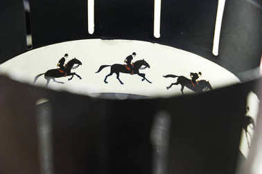 A zoetrope is one of several pre-film animation devices that produce the illusion of motion by displaying a sequence of drawings. Illustrative photo