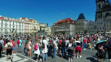 Tourists on Old Town Square, Tyn Church