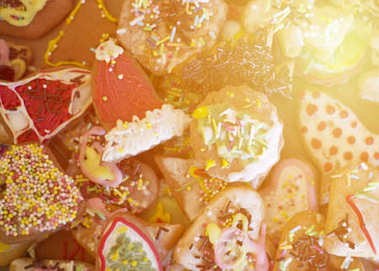 Close up on colorful gingerbread cookies with sun flare