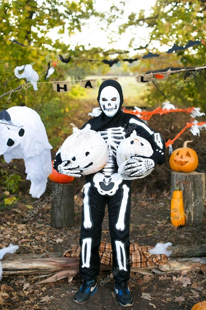 toddler dressed as a skeleton at the feast Halloween