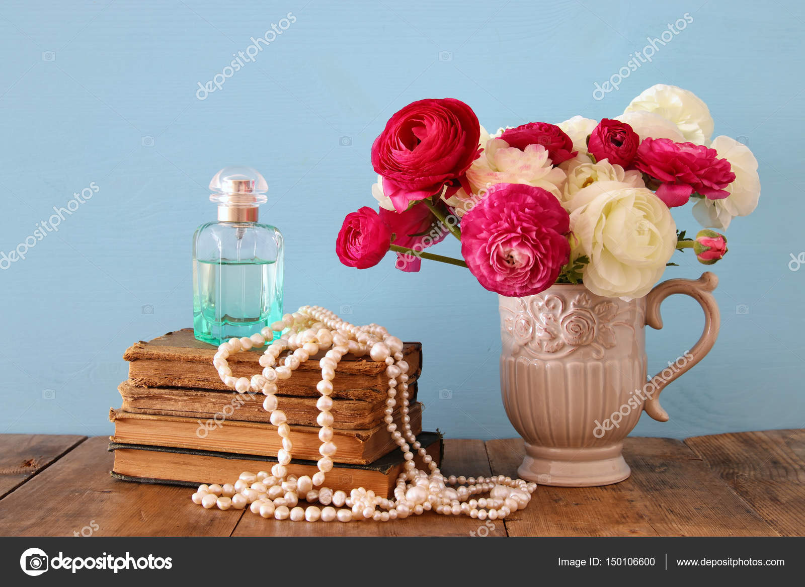 Flowers in the vase next to old books pearls necklace and perfume beautiful bouquet of spring flowers in the vase next to old books pearls necklace and perfume bottle on wooden table photo by tomert reviewsmspy