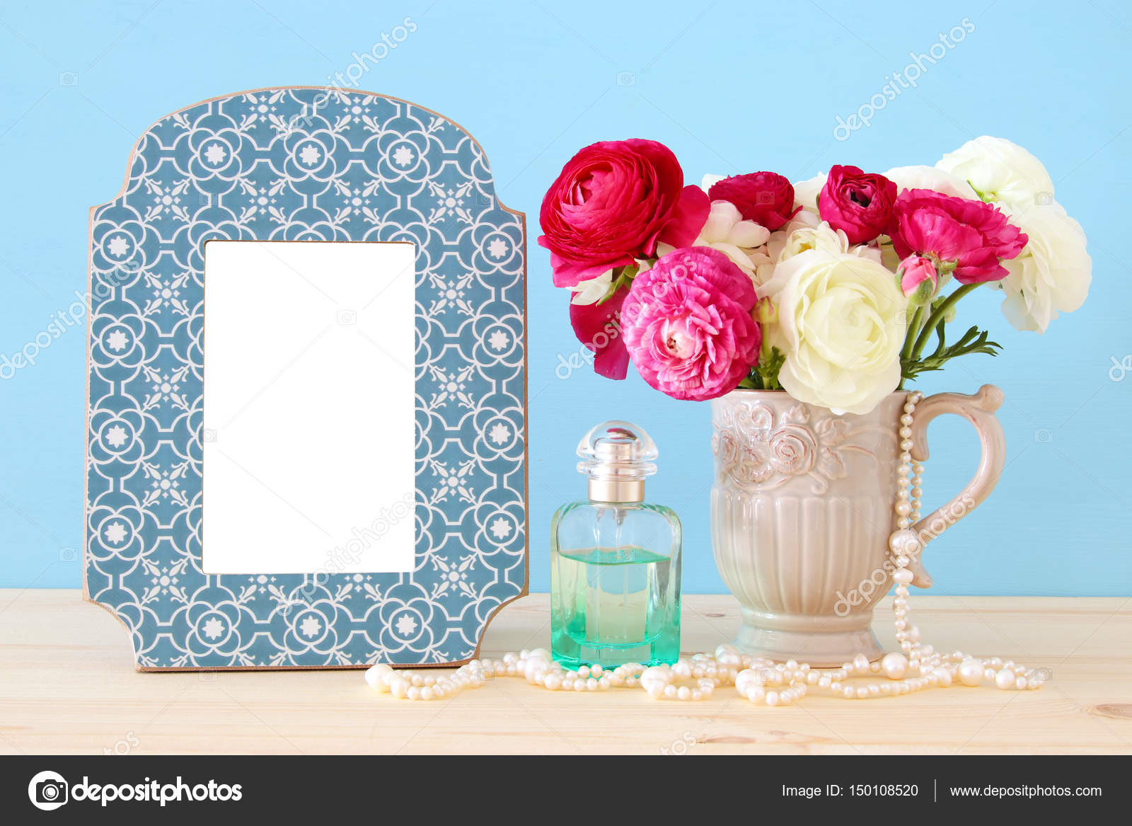 Spring flowers perfume bottle and pearls next to blank vintage spring flowers perfume bottle and pearls next to blank vintage photo frame stock photo mightylinksfo