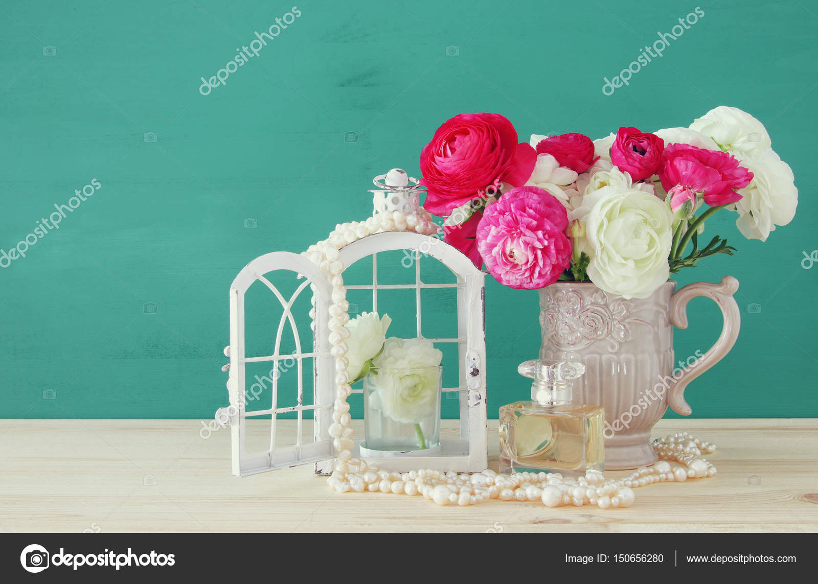 Flowers in the vase next to pearls necklace and perfume bottle beautiful bouquet of spring flowers in the vase next to pearls necklace and perfume bottle on wooden table photo by tomert reviewsmspy
