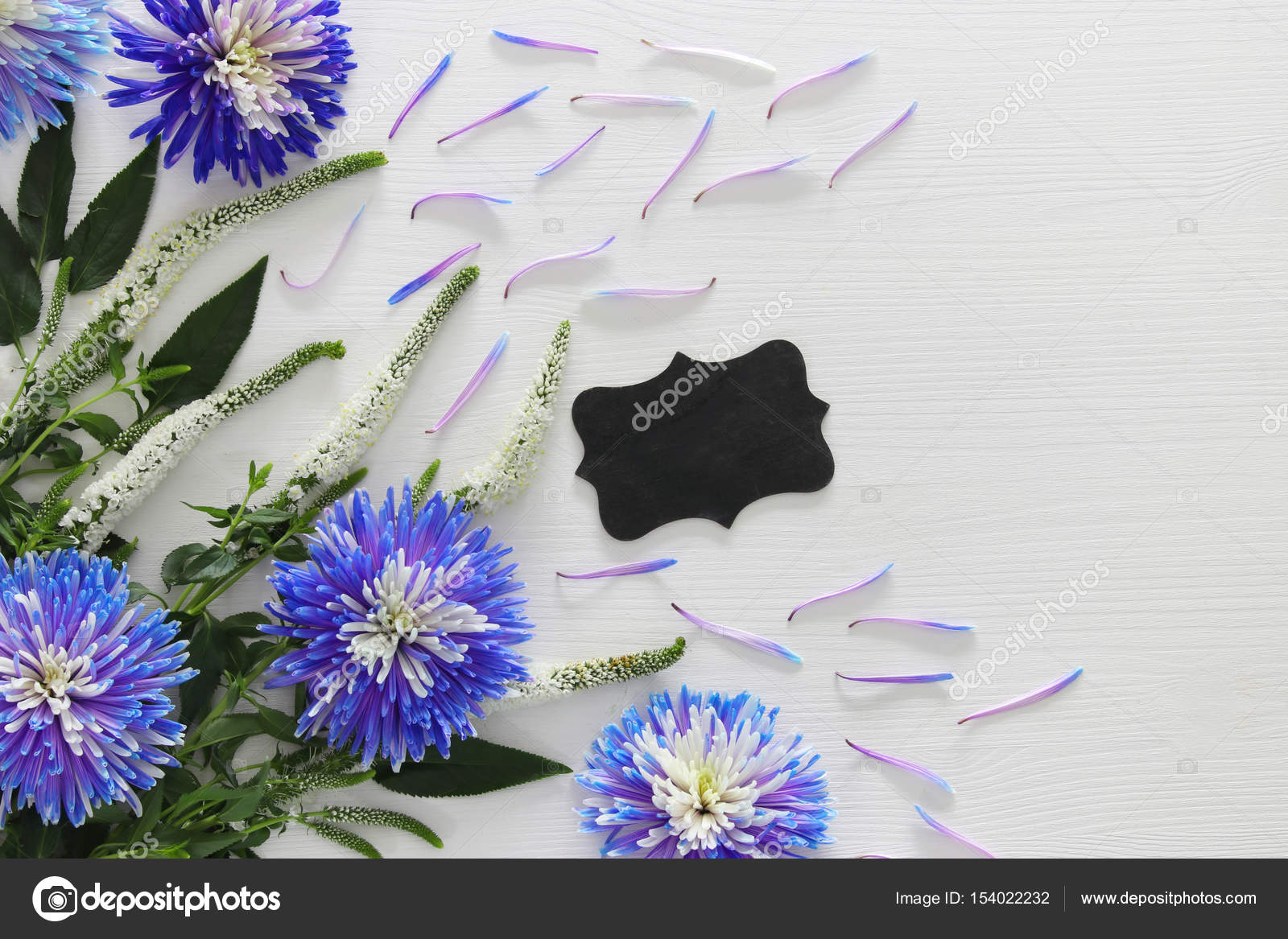 Blue and white flowers arrangement and blackboard stock photo blue and white flowers arrangement and blackboard stock photo izmirmasajfo