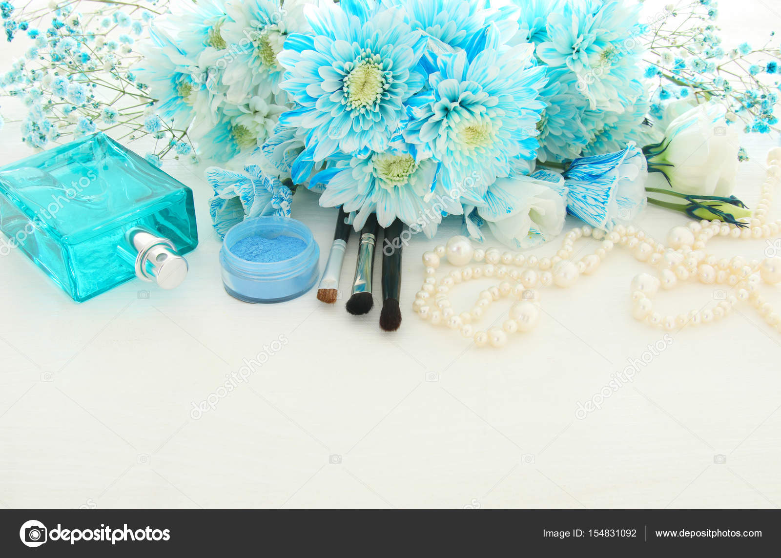 Beautiful and delicate blue flowers arrangement next to pearls beautiful and delicate blue flowers arrangement next to pearls necklace fresh perfume and makeup izmirmasajfo