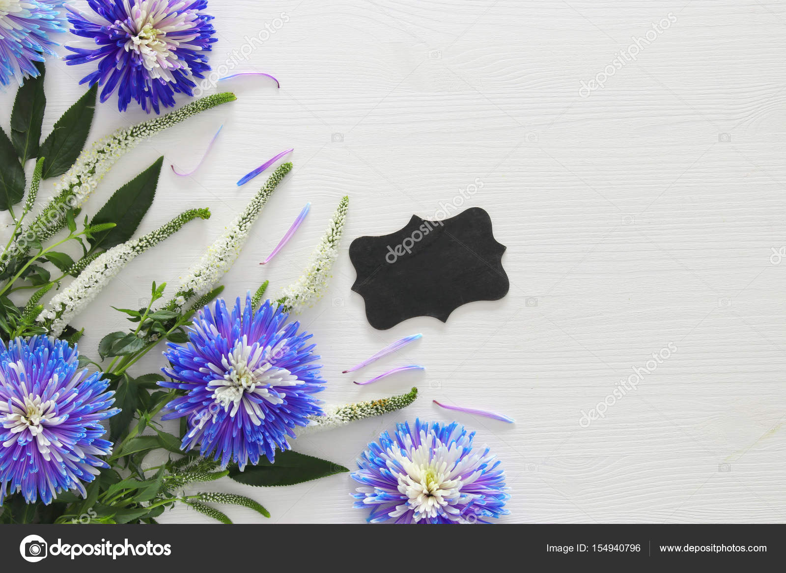 Blue And White Flowers Arrangement And Blackboard Stock Photo