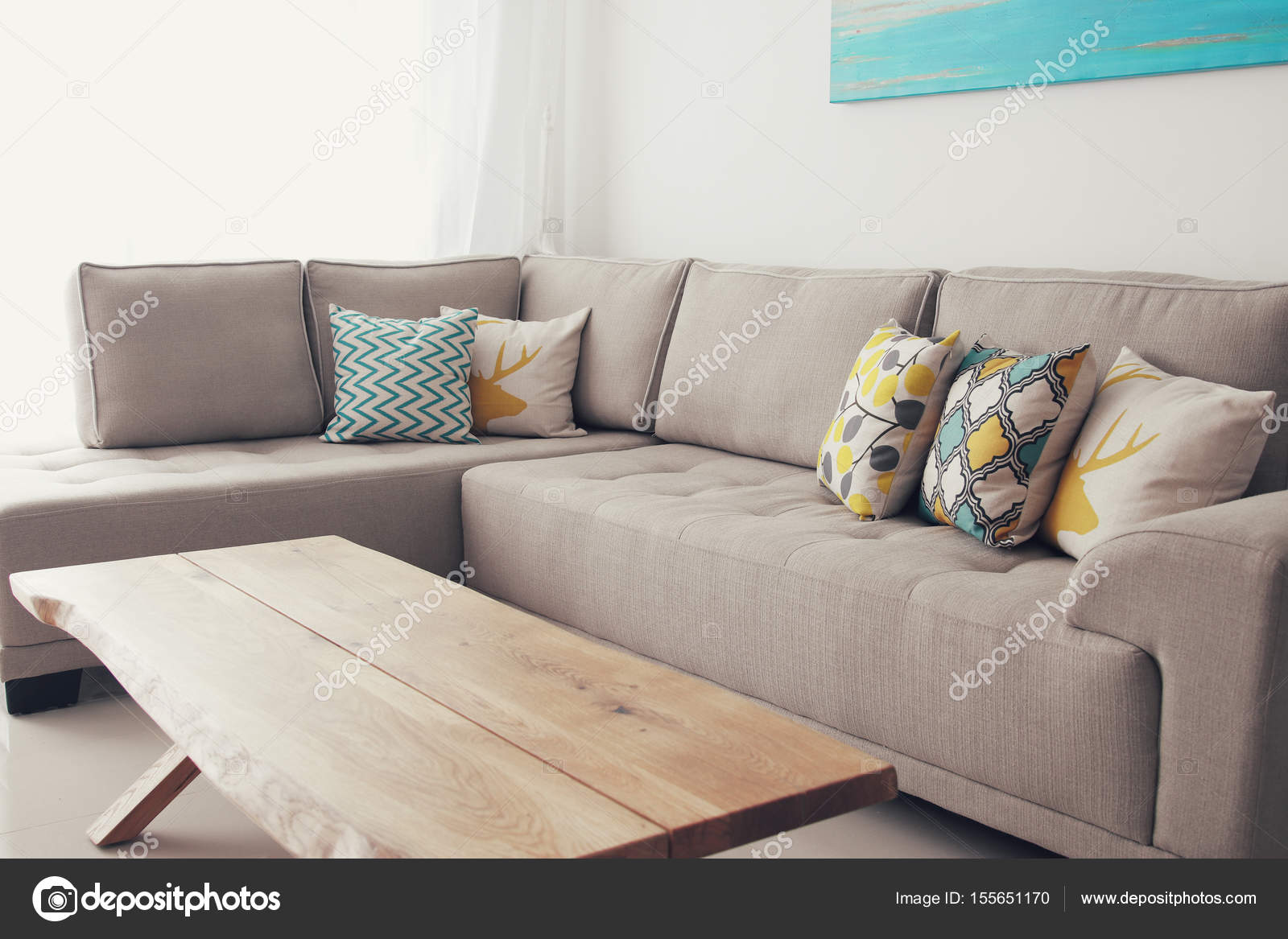wooden empty table in front of living room sofa interior stock rh depositphotos com round coffee table in front of sofa round coffee table in front of sofa