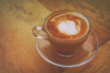 image of coffee cup over old wooden table