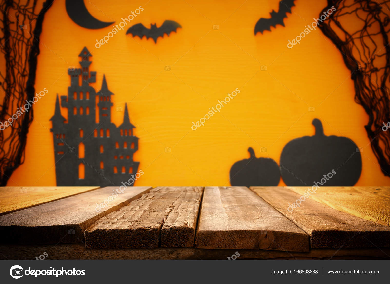 Halloween Holiday Concept Empty Rustic Table In Front Of Spider Web Pumpkins Witch House And Bats Background Ready For Product Display Montage Photo