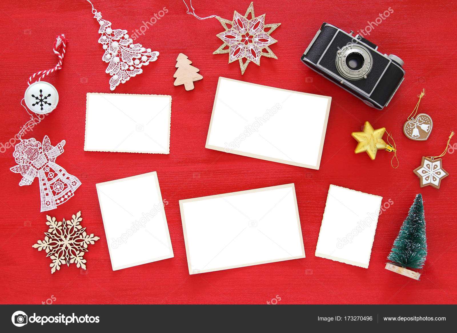 Top view image of christmas festive decorations next to old camera ...
