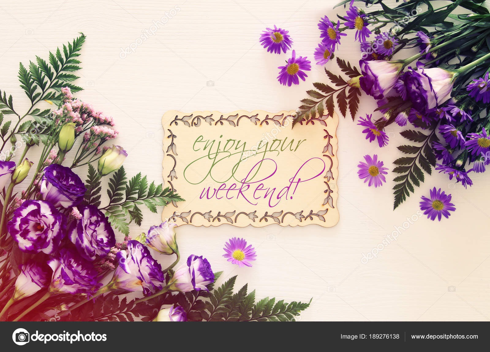 Top View Of Purple Beautiful Flowers Arrangement On White Wooden
