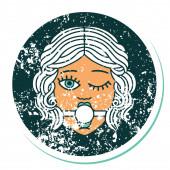ikonische Distressed Sticker Tattoostil Bild eines zwinkernden weiblichen Gesichts trägt Ball-Gag