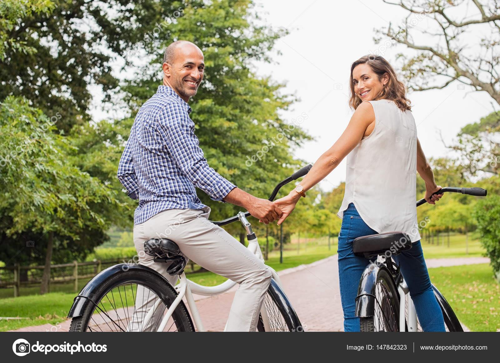 mature couple riding bicycle — stock photo © ridofranz #147842323