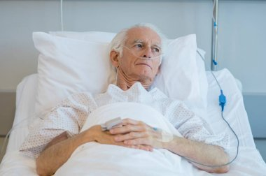 Old patient lying on bed