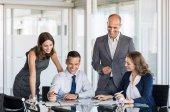 Fotografie Businesspeople in meeting room