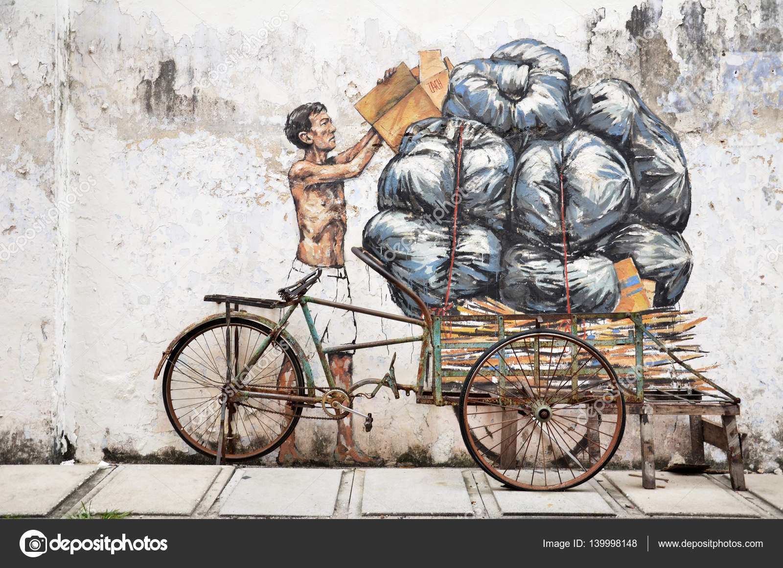 Trishaw painted by ernest zacharevic in ipoh stock photo
