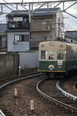 Retro-style tram of Randen Kitano Line appoaching Omiya Station