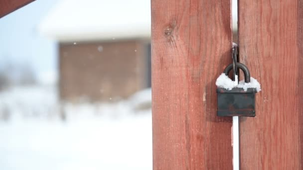 Rustic wooden fence in country style close-up. Winter, snow, suburban life