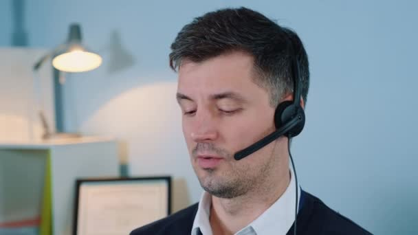 Close-up of caucasian call center agent talking in headset on phone