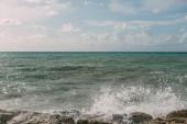 splash of water from mediterranean sea on wet rocks