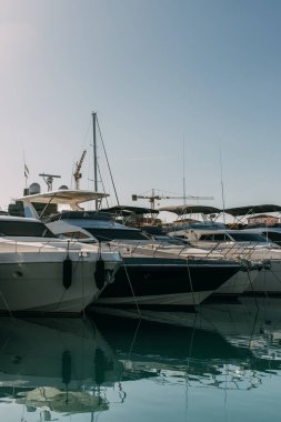 sunshine on docked and modern yachts in mediterranean sea