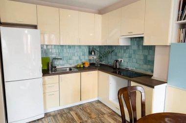 Modern fridge near sink and faucet in modern kitchen stock vector