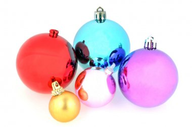 Christmas balls of different colors in closeup on white background