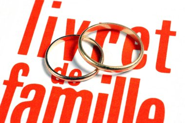 Family booklet with wedding rings close-up