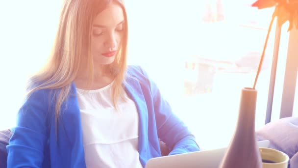 business woman in blue jacket working with laptop